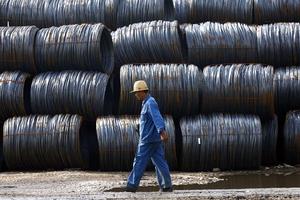 Trabalhador da China Steel (Foto: Getty Images)
