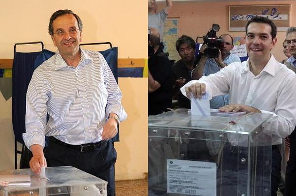 Os candidatos gregos Antonis Samaras, da Nova Democracia, e Alexis Tsipras, do Syriza, durante a votação (Foto: Agência EFE)