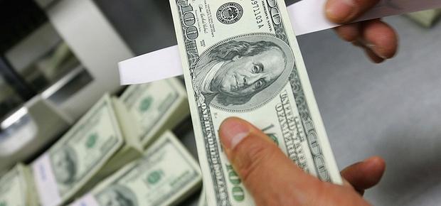 Declarações do governo sobre câmbio não seguraram queda da moeda (Foto: Getty Images)