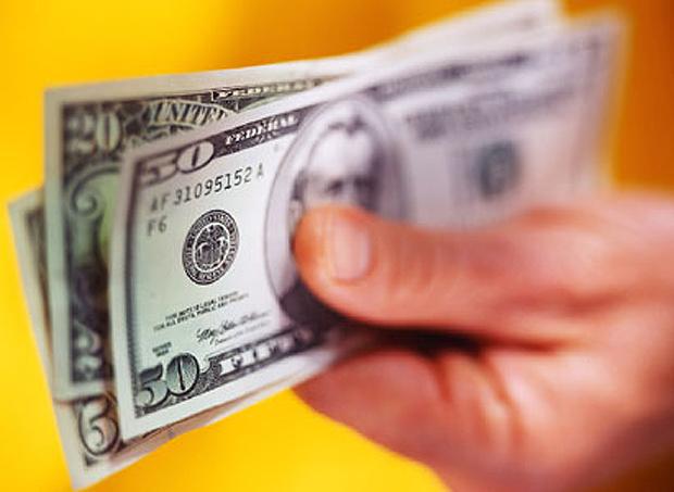 Fala de Mantega sobre câmbio não refletiu na moeda (Foto: Getty Images)