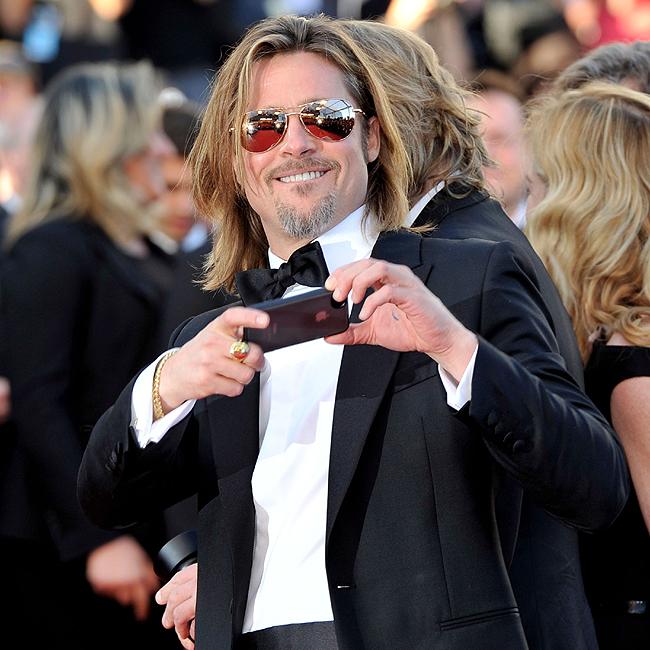 Brad Pitt fotografou tudo no tapete vermelho do longa